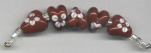 Floral Lampwork Hearts by tiannei