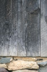 weathered wood and stone background by Dom410