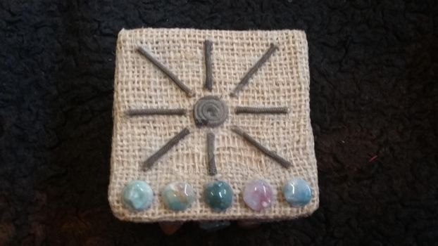 Small tarot box pic #2-top view stones  sun by branika
