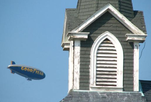 Goodyear Blimp and Steeple by zombieguy