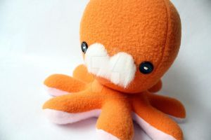 Orange mustache plushie by jaynedanger