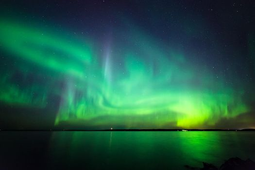 Northern lights at lake by JuhaniViitanen