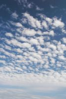 clouds at the beach by MorgaineA