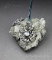 Twigs with moonstones by drakonaria