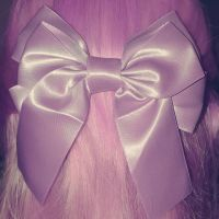 Pink bow... by MovesInSilence