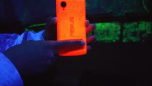 The Red Nexus 5 under a blacklight. by techboy411