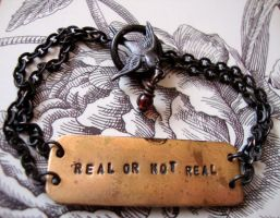 The Hunger Games Real OR Not Real Bracelet by Lady-Callie