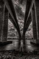 Concrete arches - troubled sky by GeoffSporne