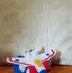 GIF of Plush Starscream transforming by feltgood