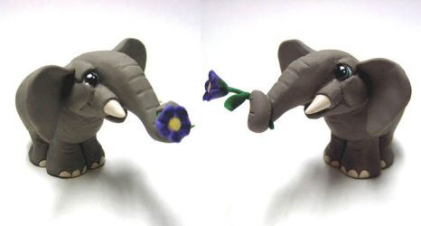 elephant with flower by dragonember