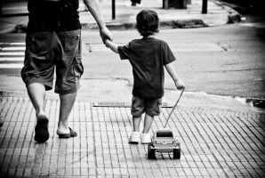 father son and plastic truck by anahuac