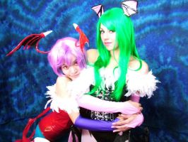 Lilith and Morrigan by cerezosdecamus