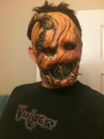 strap on pumpkin face by UglyBabyEater