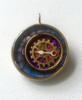Circle pendant with watch hand by sillysarasue