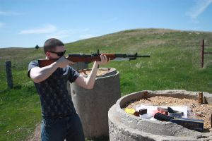 man firing SKS assault rifle by psychoelfstock