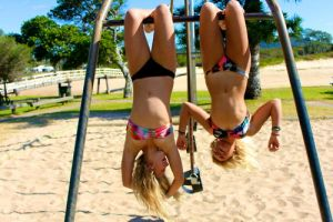 Two Girls Hanging Up Side Down by tummytickleztickler