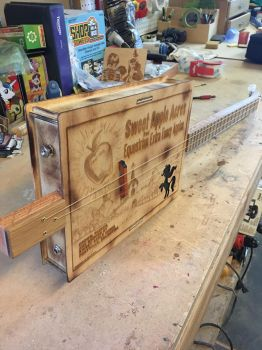 The finished Sweet Apple Acres Cigar Box Guitar by DustyPony