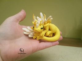 Yellow glow in the dark angel dragon by claymeeples