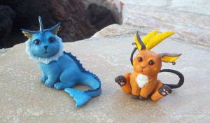 Vaporeon and Raichu Sculptures
