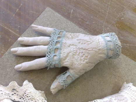 ceramic hand with lace pattern by rasdaughter