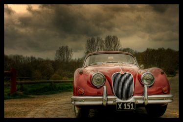 Red Veteran car by Initio