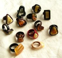 Wooden rings with baltic amber by AmberSculpture