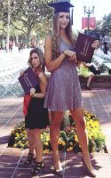 Tall woman and short woman at graduation by lowerrider