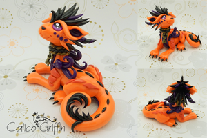Orange laying Cayo Dragon by CalicoGriffin