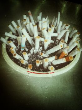 Time to quit smoking... by DrinkFromHumanSkulls