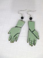Hand painted spooky monster hand earrings by TanzenLilly