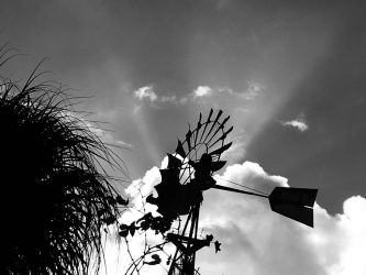 Windmill beyond the clouds black and white  by Saraeustace91