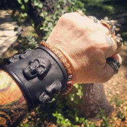 Leather 3 skull wrist band by GriffinLeather
