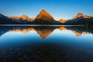 Sunrise at Swiftcurrent by porbital
