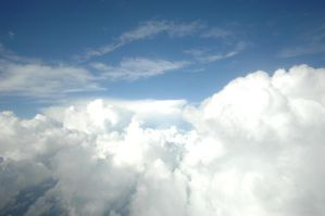 clouds puffy in Sky Blue stock by ebstock