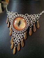 Bronzed fire eye in chainmaille with bronze dagger by BacktoEarthCreations
