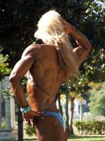 Muscle Girl in the Garden by hardbodies