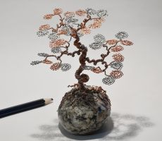 Wire tree sculpture on the rock by minskis