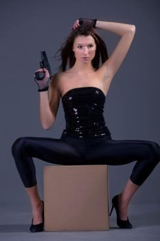 sexy woman with gun by InnaModel