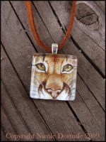 Cougar Stare glass pendant by thornwolf