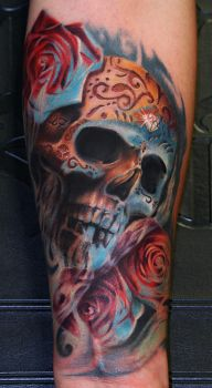 Skull tattoo by Remistattoo