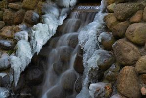 Icy waterfall by Moonbird9