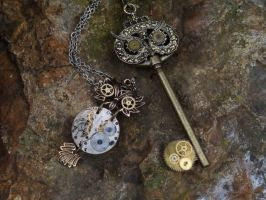 Steampunk owl necklaces II by Hiddendemon-666