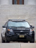 Cop Car parked at the State Capital MadisonWI 2013 by Crigger
