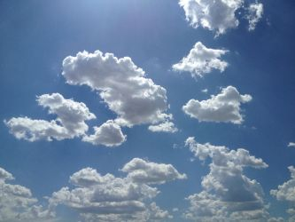 Puffy Cloud Skies by Makes-Wishes