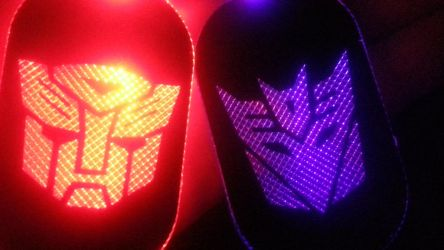 Autobot and Decepticon LED tags by AomiArmster