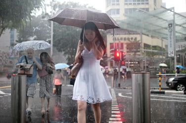 Lady in White in Rain by dannyst