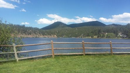 Mountain lake with fence by FlowersAndHorses