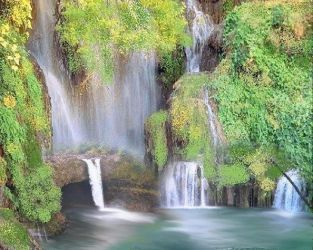 MANY WATERFALLS IN THE POND by lmtcloud