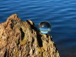 Glass sphere above the water by Acrylicdreams