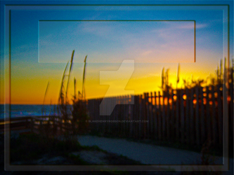 Ocean Sunrise Through Wooden Fence And Sea Oats by BlakeHenryRobson